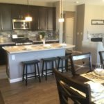 Kitchen and Dining of model at High Point by Century Communities in Denver.