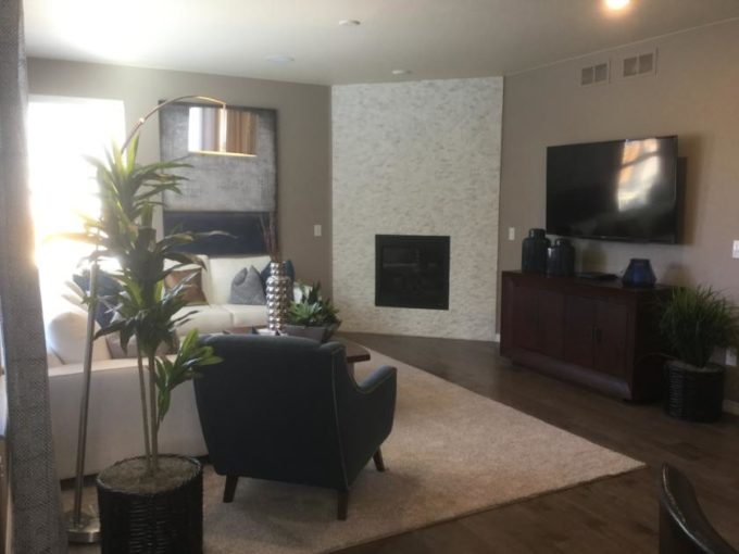Family room of the Legacy model by Lennar at Stapleton in Denver