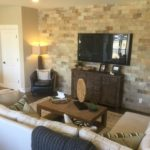 Family room of the Cedar model by KB Homes at Stapleton in Denver