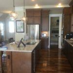 Kitchen of the Asheville model by Parkwood Homes at Stapleton in Denver