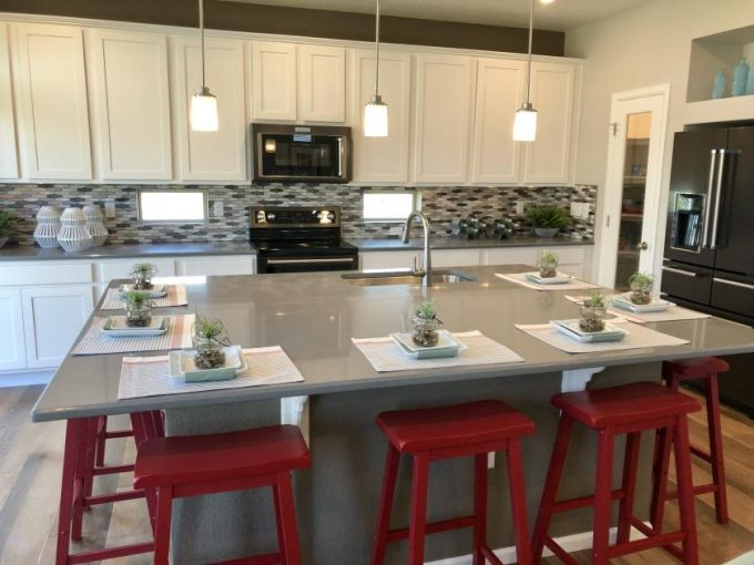 The Lansford model by Oakwood Homes at Reunion in Commerce City, Colorado.