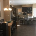 Kitchen and dining of Speer Model by Thrive at Stapleton in Denver