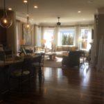 Main living area of the Asheville model by Parkwood Homes at Stapleton in Denver