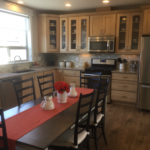 Kitchen in the Highland model by Thrive Home builders at Stapleton in Denver
